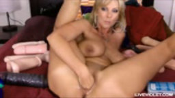 Naughty big titted blonde Alysha fists pussy and fucks ass