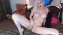 Busty blonde Lollie plays with her stunning body and pussy