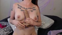 Tattooed red headed girl next door masturbates pussy