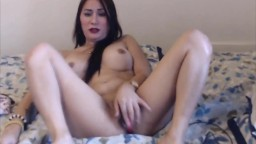 Sweet Asian girl Pamela with pretty smile and big tits