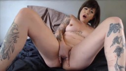 Dirty talking tattooed babe fingering tight little pussy