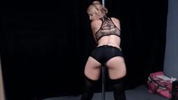 Sexy dancer Scarlett Daniels in black stockings and high heels