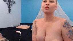 Bald liberated girl masturbation near the cam