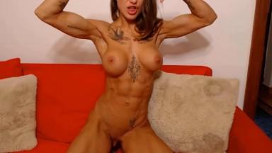 Spanish inked bodybuilder masturbates immense clitoris