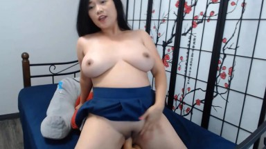 Curvaceous Asian student stuffs dildo in her meaty cunt