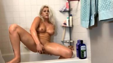 Flexible blonde Marley bangs her slutty vagina in bath