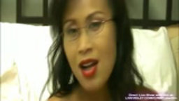 Sexy asian Kim with glasses masturbates